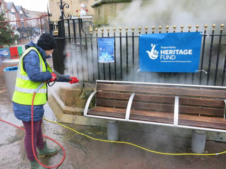 A Townscape Heritage Project volunteer is instructed in the use of ThermaTech stone masonry cleaning equipment, by personnel from the specialist conservation company Recclesia.