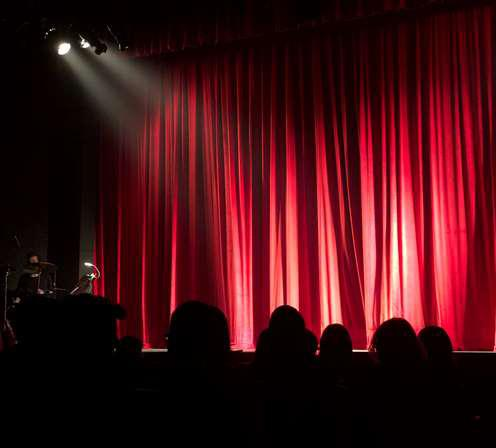 Image of theatre red curtains