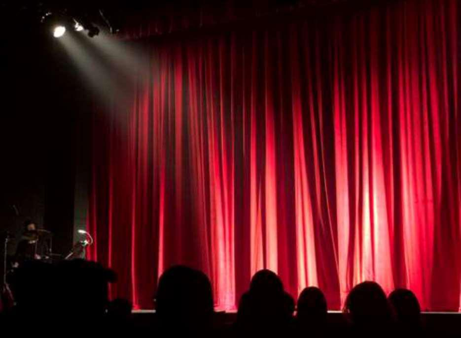Image of red curtains at the theatre